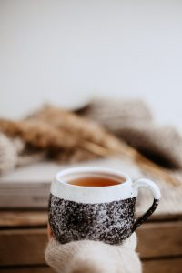 tea cup in hand