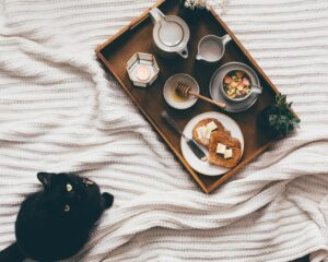 tea on bed with cat